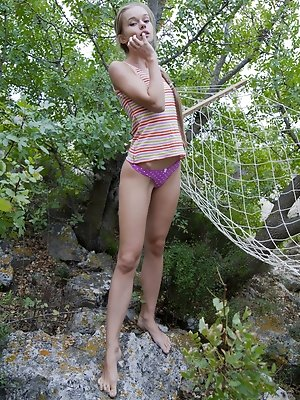 Blue-eyed cutie Milena D playfully posing on a hammock while showing off her nubile assets. pics ~ hot-pussy.cc