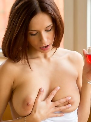 A glass of red wine and Tracy Smile is already feeling naughty, touching her sensitive lady bits. pics ~ hot-pussy.cc